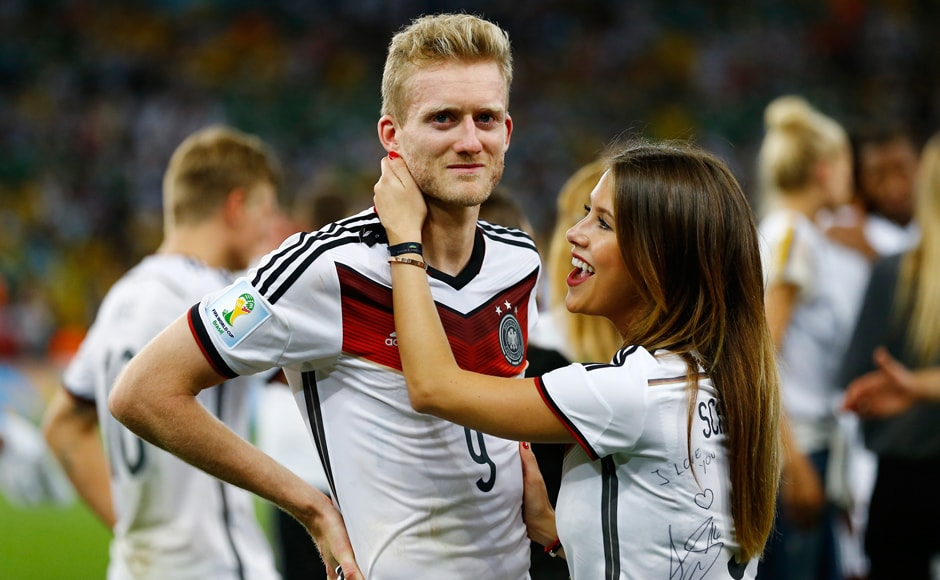 An emotional Andre Schuerrle is congratulated by girlfriend Montana Yorke. Reuters