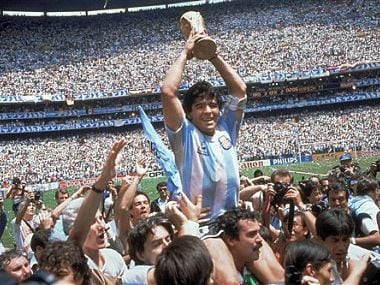 In this June 29, 1986, file photo, Diego Maradona, holds up the trophy. AP