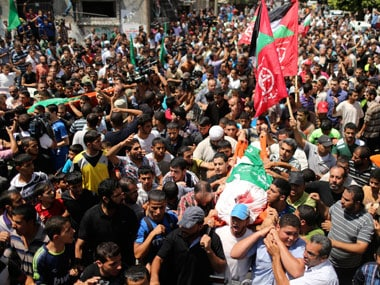 Palestinians march during the funeral of the wife of Hamas's military leader, Mohammed Deif, his infant son Ali and other Palestinians. Reuters image