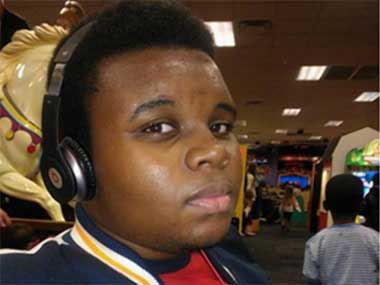 Ferguson teen had his arms raised when cop shot him: New witnesses