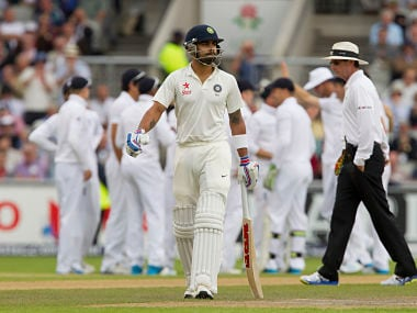 India's Virat Kohli walks back after being dismissed for a duck. AP