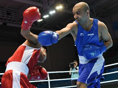 India's Akhil Kumar (R) throws a punch against Nepal's Puma Bahadur Lama (L) in the men's light 60kg preliminaries session 2. AFP