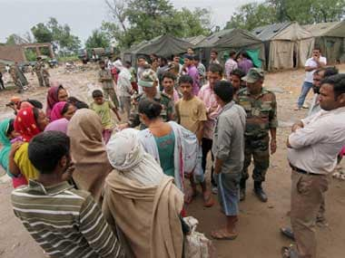 Flood-affected families at an army relief camp at Sure Chak village in Jammu on Sunday. PTI