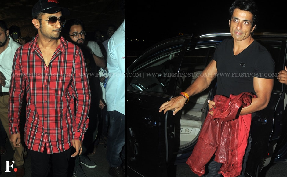 The cast of 'Happy New Year' was seen at the Andheri airport on Wednesday early morning, leaving to the US for their mega Bollywood show, The Slam Tour. They will touring six venues in a span of two weeks. Yo Yo Honey Singh (L) and Sonu Sood are seen here. Sachin Gokhale/Firstpost
