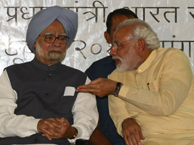 A file photo of former Prime Minister Manmohan Singh with present Prime Minister Narendra Modi. AFP