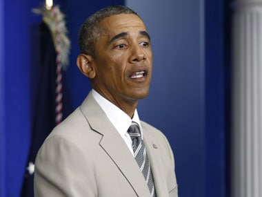 Obama in his infamous tan suit. Reuters