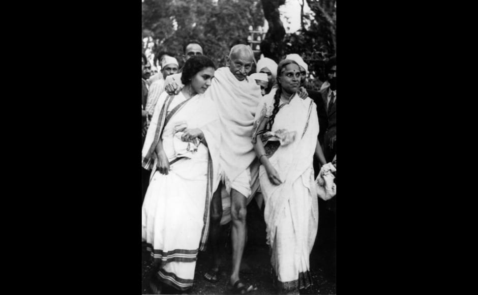 Indian nationalist leader Mahatma Gandhi (Mohandas Karamchand Gandhi) leaving Maor Ville, his Simla residence, during the Leaders Conference.  He is helped to his car by his doctor Sushelia Nayyer, right, and Susila Ben, left, and accompanied by his private secretary Mr Piare Lal.   (Photo by Fox Photos/Getty Images)
