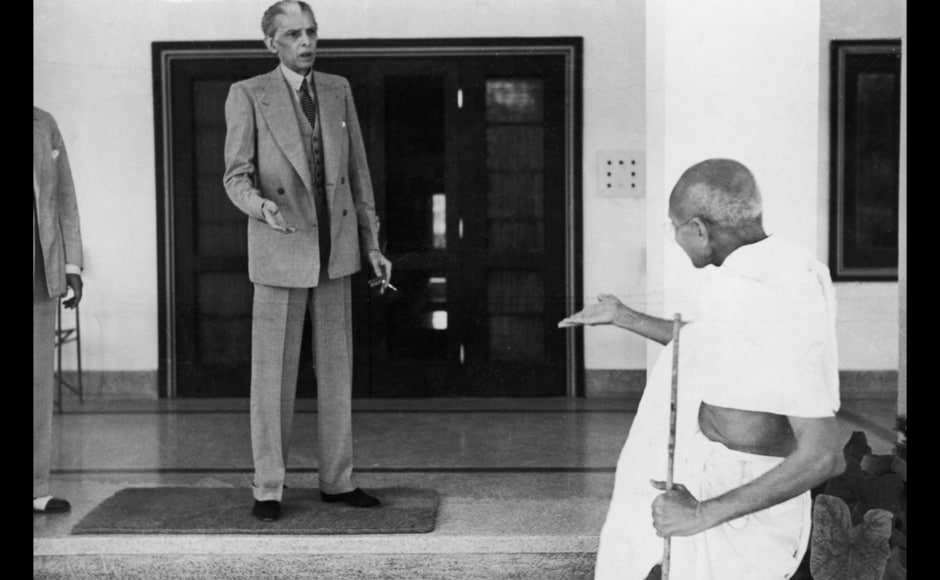 Mohandas Karamchand Gandhi (1869 - 1948) leaves the home of Muhammad Ali Jinnah (1876 - 1948, left), founder of the Muslim League, en route to the Viceroy's Lodge in Delhi, 24th November 1939. (Photo by Topical Press Agency/Hulton Archive/Getty Images)
