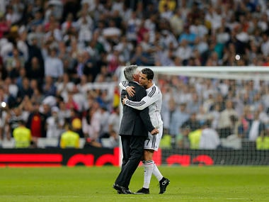 Real Madrid's coach Carlo Ancelotti, left, and Cristiano Ronaldo embrace at the end of a Spanish La Liga soccer match between Real Madrid and Barcelona. AP