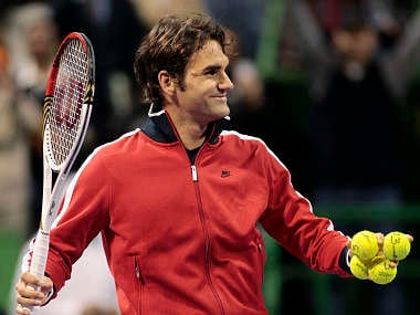 Federer battles past Chardy in Paris to keep hopes of reclaiming top spot alive