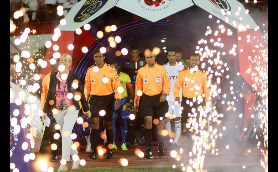 match officials are entering the field during match 2 of the Hero Indian Super League between NorthEast United FC and Kerala Blasters FC held at the Indira Gandhi Stadium, Guwahati, India on the 13th October 2014. Photo by:  Saikat Das/ ISL/ SPORTZPICS
