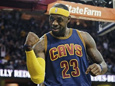 Cleveland Cavaliers  LeBron James gestures to the crowd in the first  quarter. AP 5cfe34747