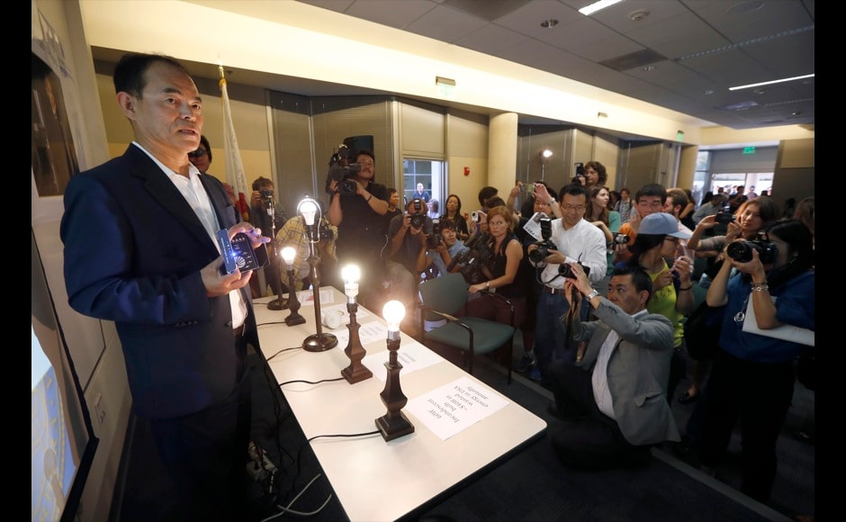Japanese-born U.S. citizen Shuji Nakamura (L) holds a blue LED light at a news conference after winning the 2014 Nobel Prize for Physics, at the University of California Santa Barbara in Isla Vista, California October 7, 2014. An American and two Japanese scientists won the 2014 Nobel Prize for Physics on Tuesday for inventing a new energy-efficient and environment-friendly light source, leading to the creation of modern LED light bulbs. Isamu Akasaki and Hiroshi Amano of Japan and Nakamura won the prize for developing the blue light-emitting diode (LED) -- the missing piece that now allows manufacturers to produce white-light lamps.  REUTERS