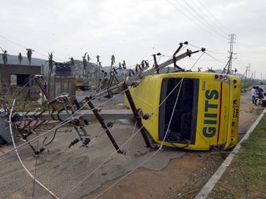 Power lines and a passenger bus show the damage that cyclone Hudhud caused. Reuters