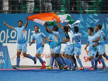 India's hockey team celebrates after winning the gold at the Asian Games. AP