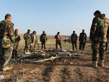 Kurdish Peshmerga forces inspect a site in Hardan village in northern Iraq, where Islamic State group fighters allegedly executed people from the Yazidi sect captured when they swept through the area in August. AP