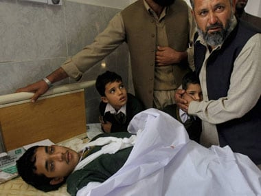 An injured student after he was rescued from the army school in Peshawar.