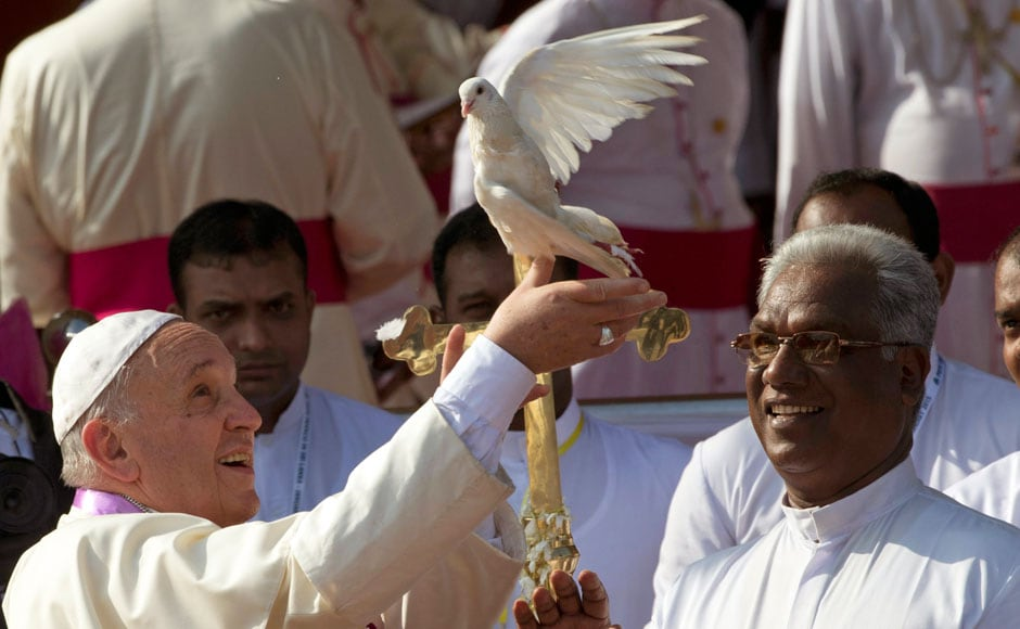 "Pope Francis releases a dove in Madhu, Sri Lanka. Pope Francis traveled to the jungles of war-torn northern Sri Lanka on Wednesday to show solidarity with the victims of the country's 25-year civil war and urge forgiveness and reconciliation ""for all the evil which this land has known."" AP"