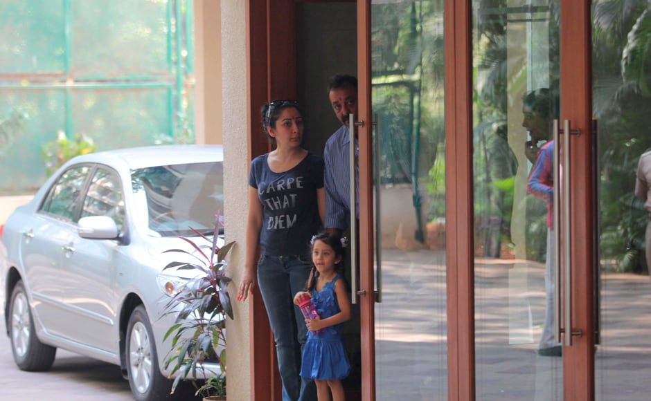 Sanjay Dutt with his wife Manyata and one of his children, as he prepares to leave his home for Yerwada jail: Firstpost