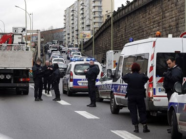 """Police forces gather together on the """"peripherique"""" (circular road) after at least one person was injured when a gunman opened fire at a kosher grocery store in Porte de Vincennes. AFP"""