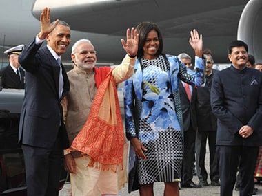Orange pashmina shawl, pinstriped suit: Modi nearly steals Michelles fashion thunder