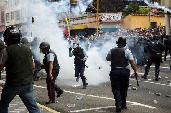 Violence flares in Venezuela on anniversary of 2014 fatalities