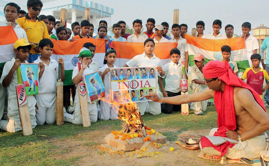 Young cricket fans perform yajna for the Indian Cricket team's victory ahead of their Semi final clash with Australia of ICC Cricket World Cup-2015, at Balurghat in South Dinajpur district of West Bengal on Wednesday. PTI