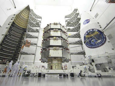 Magnetospheric Multiscale (MMS) observatories are processed for launch in a clean room at the Astrotech Space Operations facility. AP
