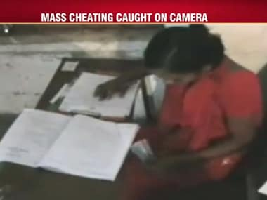 Bihar cheating scam: Family members climb buildings, pass chits to students taking exams