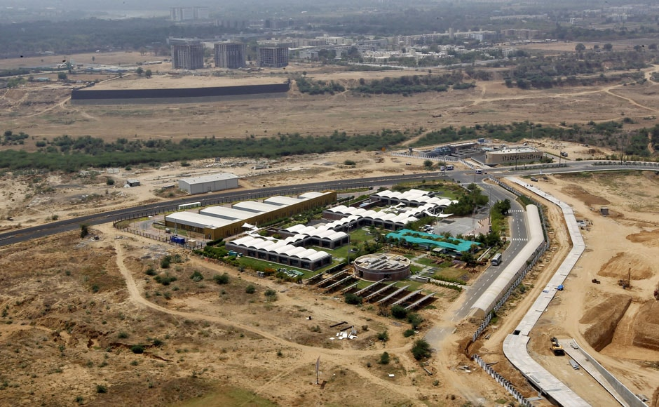 """An aerial view of a site under construction at the Gujarat International Finance Tec-City (GIFT) at Gandhinagar, in the western Indian state of Gujarat, April 11, 2015. India's push to accommodate a booming urban population and attract investment rests in large part with dozens of """"smart"""" cities like the one being built on the dusty banks of the Sabarmati river in western India. Picture taken April 11, 2015.  REUTERS"""