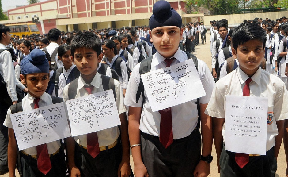 Ranchi : Students of a school in Ranchi paying tribute to earthquake victims of Nepal on Monday. PTI