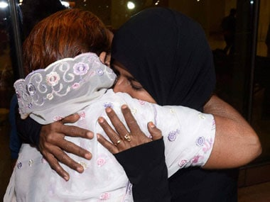 A relative receives one of the Indian nationals evacuated from Yemen, upon their arrival at the International Airport in Mumbai on early Saturday morning. PTI