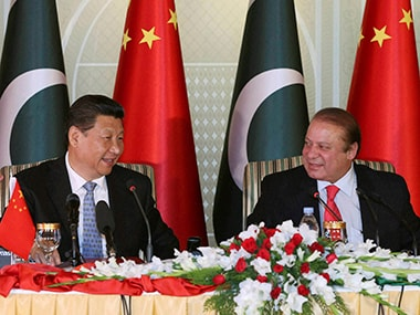 In a photo released by China's Xinhua News Agency, Chinese President Xi Jinping with Pakistan's Prime Minister Nawaz Sharif attend a press conference in Islamabad. AP