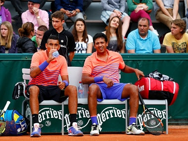 Nick Kyrgios and Mahesh Bhupathi during a break in play in their Men's Doubles match against  Thanasi Kokkinakis and Lucas Pouille. Getty
