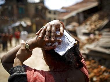 A woman injured in an earthquake walks toward a hospital soon after the earthquake in Sankhu