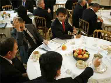 Louisiana Governor Bobby Jindal speaks with fellow governors and guests at the White House in Washington