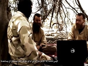 In a 19-minute video, al Qaeda jihadist parades western hostages