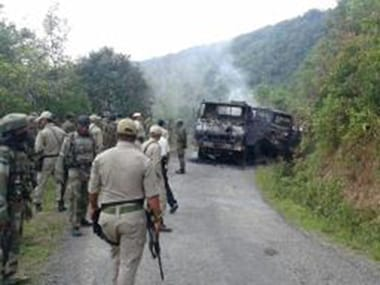 A smoldering vehicle wreckage at the scene of Thursday's attack in Manipur's Chandel district. AFP