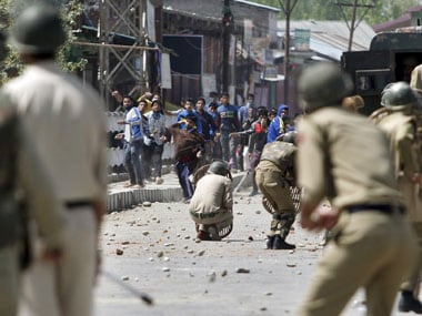 Stone pelters and security personnel clash on a Srinagar street. Reuters