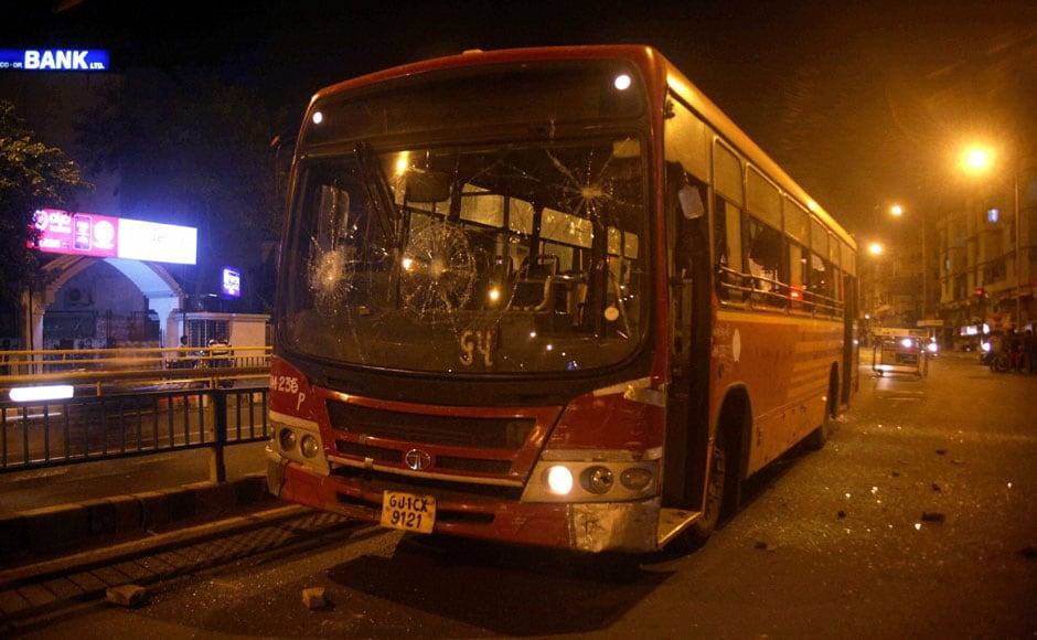 Ahmedabad: A bus damaged by people after the arrest of Hardik Patel, convener of 'Patidar Anamat Andolan Samiti, in Ahmedabad on Tuesday.   PTI