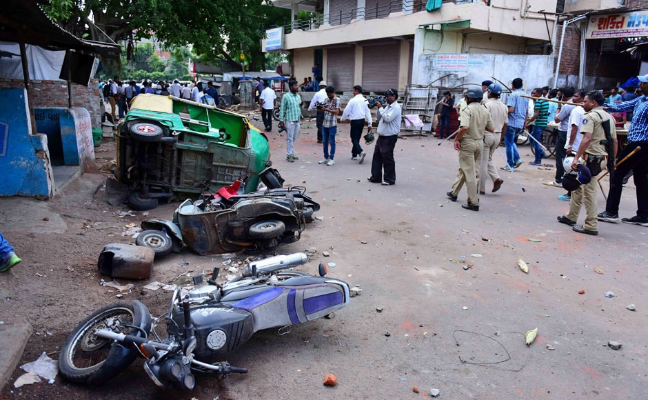 Ahmedabad: Police charge Patel community members after their agitation for reservation turned violent in Ahmedabad on Tuesday. PTI