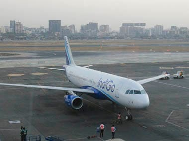 An IndiGo Airlines aircraft arrives at a gate of the domestic airport in Mumbai