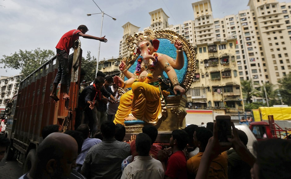 In Mumbai, devotees are seen carrying an idol of the elephant-headed god. There are said to be about 7,000 Ganpati mandals in the city, and several families celebrate the festival at their homes as well. Image courtesy: Reuters