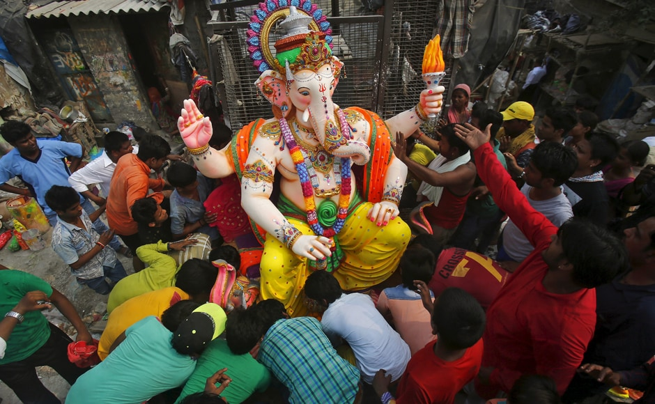 Devotees are seen preparing to load a Ganesh idol onto a truck to a place of worship in New Delhi. REUTERS/Anindito Mukherjee