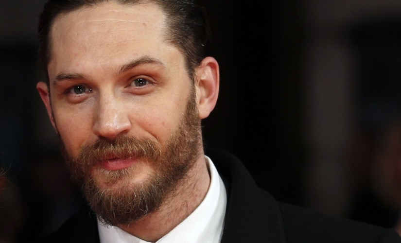 Actor Tom Hardy arrives at the BAFTA awards ceremony in London