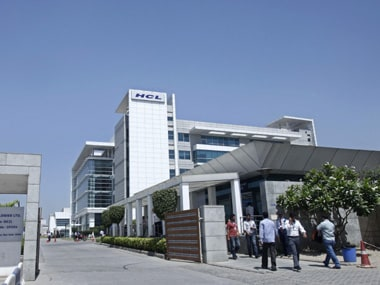 People walk in front of the HCL Technologies Ltd office at Noida, on the outskirts of New Delhi 17 April 2013. Reuters