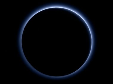 See Pluto's blue skies and frozen water in latest photos from Nasa's New Horizons