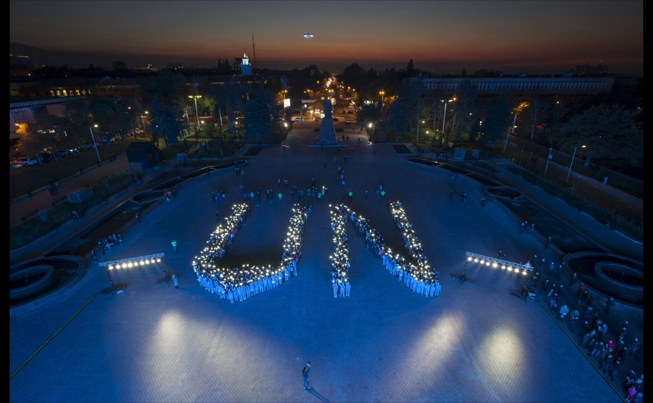 Students form the UN sign at a rally to honour the 70th anniversary of the United Nations in Almaty