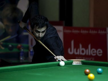 India's Pankaj Advani plays a shot during his snooker match against China?s Li Yingdong during the IBSF 6 Reds Snooker Championships in Karachi