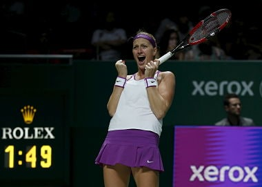 Petra Kvitova of the Czech Republic celebrates defeating Maria Sharapova of Russia in their women's singles semi-finals tennis match of the WTA Finals at the Singapore Indoor Stadium